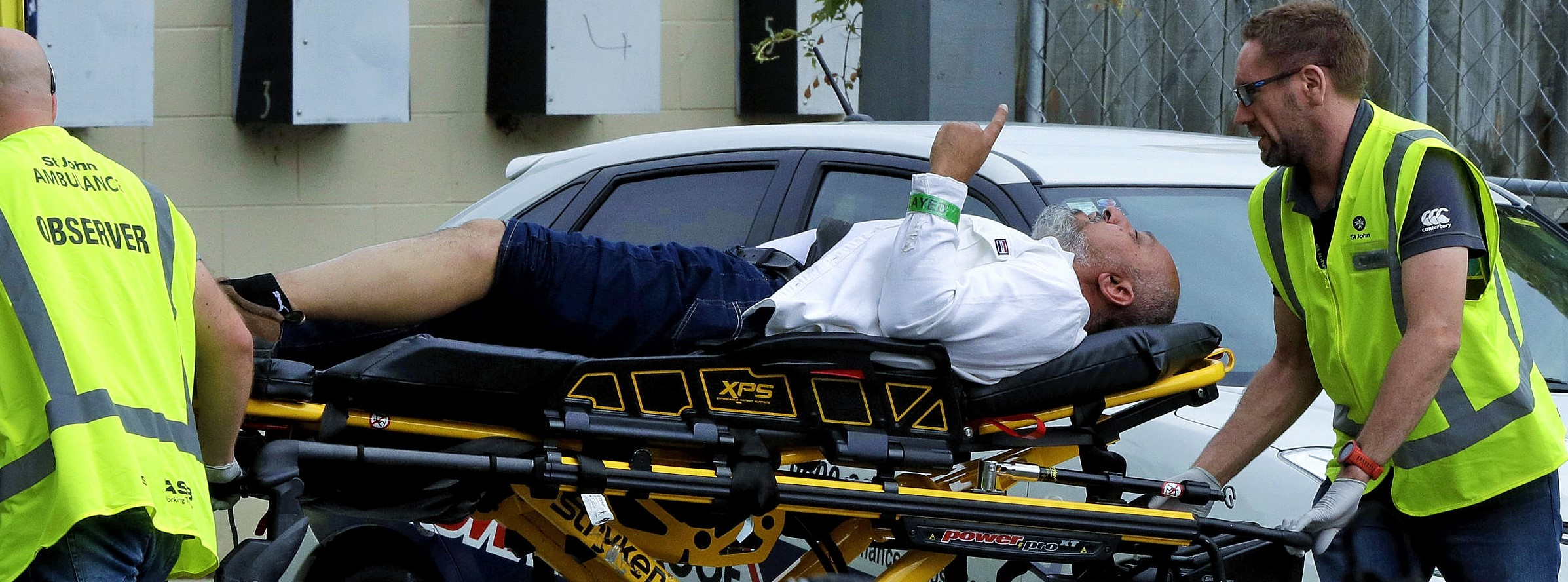 Ambulance staff take a man from outside a mosque in central Christchurch, New Zealand on Friday. Four people are in custody after shootings at two mosques there.