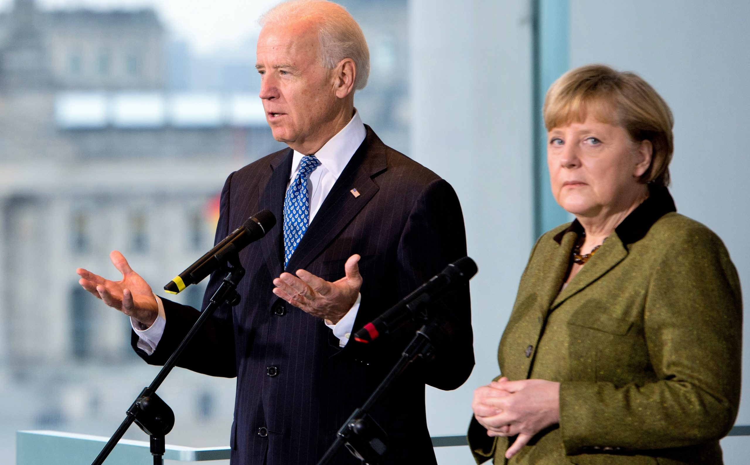 US Vice President Joe Biden and German Chancellor Angela Merkel (R) address journalists at the chancellery in Berlin on February 1, 2013. Biden is in Germany for talks with the German chancellor ahead of the Munich Security Conference. World leaders, ministers and top military brass attend three days of talks at the Munich Security Conference amid a US warning to Iran over stalled nuclear talks. AFP PHOTO / JOHANNES EISELE        (Photo credit should read JOHANNES EISELE/AFP/Getty Images)